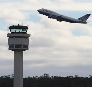 20100721103905-airport-control-tower-and-united-b747.jpg